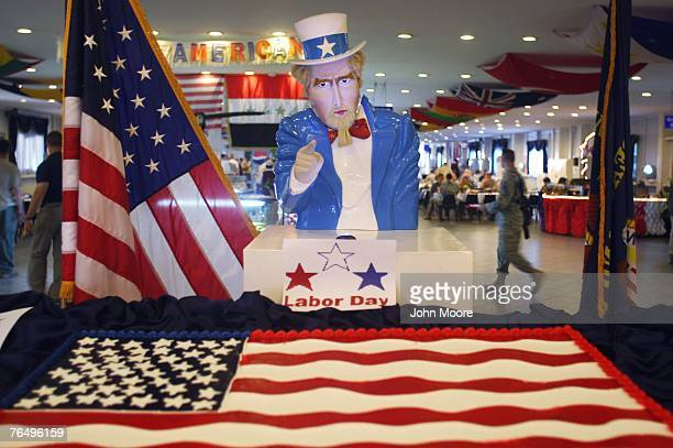 """Uncle Sam"""" stands over an American flag cake at the U.S. Embassy dining hall in the Green Zone September 3, 2007 in Baghdad, Iraq. The embassy, now..."""