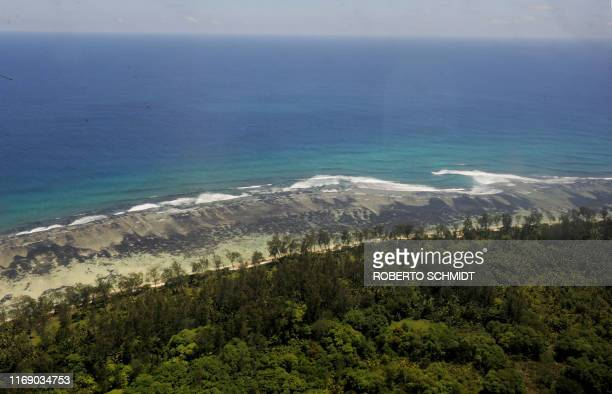UNclimatewarmingSeychellesFEATURE by JeanMarc Mojon The waters of the Indian Ocean lap on the shores of the low lying coraline island of Denis in the...