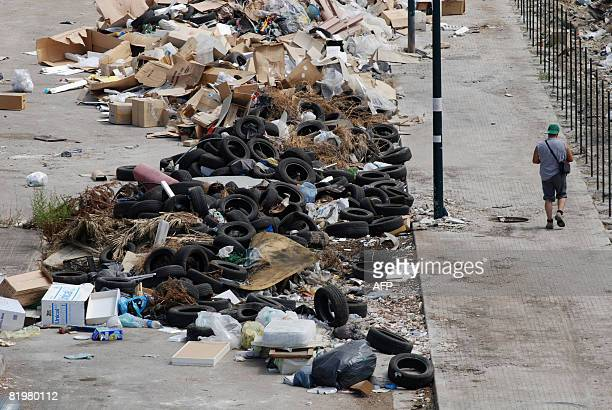 Uncollected rubbish sits on the streets of in the Ponticelli neighborhood of Naples on July 2008 as Italian Prime Minister Silvio Berlusconi...