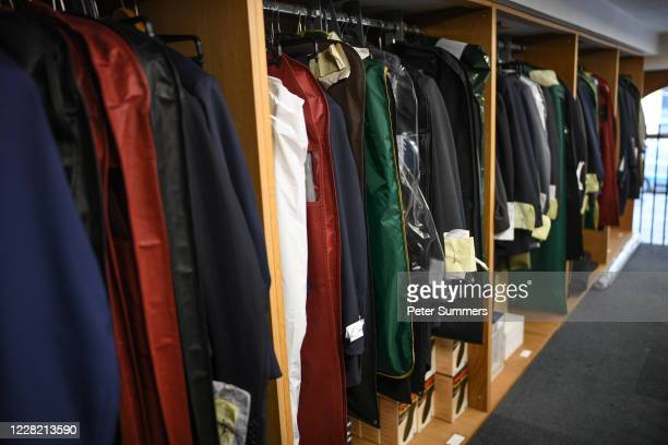Uncollected suits hang in Couch and Hoskin Bespoke Tailors in the City of London on August 26 2020 in London England Jonathan Becker owner of Couch...