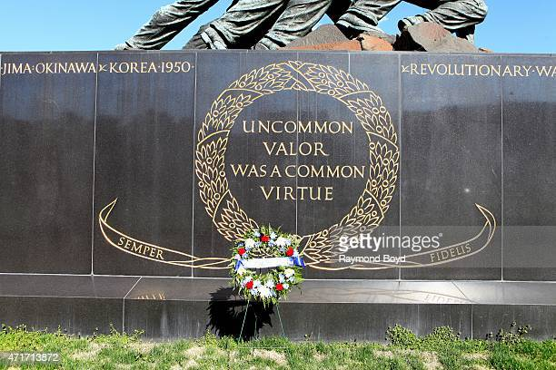 Uncommon Valor Was A Common Virtuewords at the base of the United States Marine Corps War Memorial Iwo Jima statue outside Arlington National...