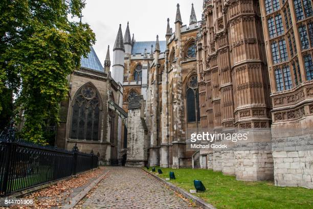 Uncommon view of Westminster Abbey with footpath out front