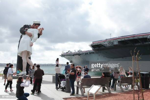 unconditional surrender statues and uss midway museum in san diego, california - midway stock photos and pictures