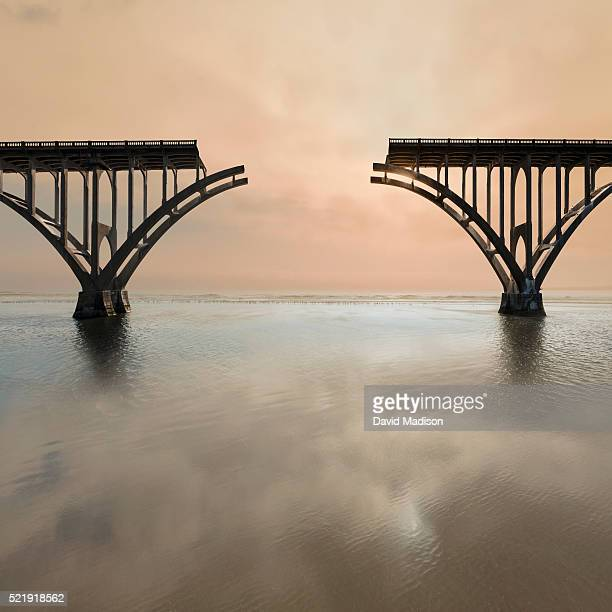 unconnected bridge above water - incomplete stock pictures, royalty-free photos & images