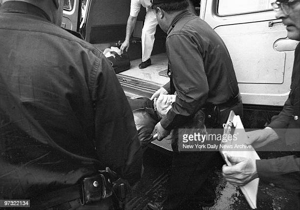 Unconscious after shooting critically wounded Andy Warhol is carried to ambulance