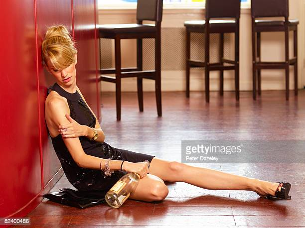 unconscious female drunk in bar - passed out drunk stock photos and pictures