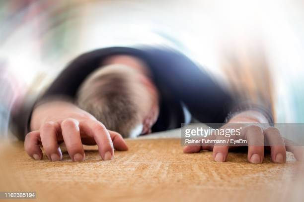 unconscious man lying down - unconscious stock pictures, royalty-free photos & images