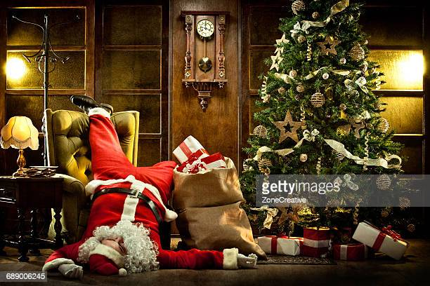 Unconscious Santa Claus in a vintage house