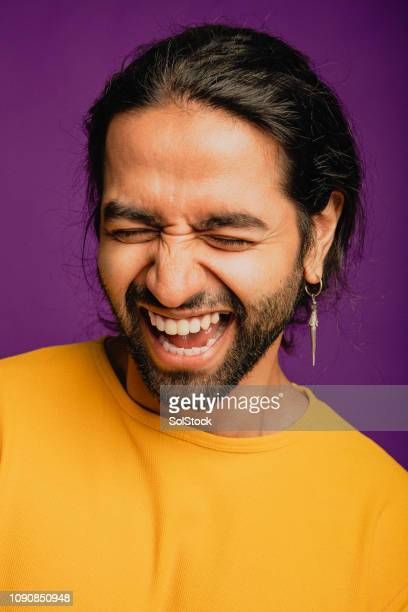 uncontrollable laughter - handsome pakistani men stock photos and pictures