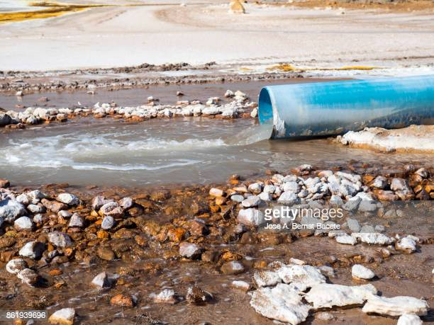 uncontrolled spillage of water with chemicals and toxic to a raft - toxic waste stock pictures, royalty-free photos & images