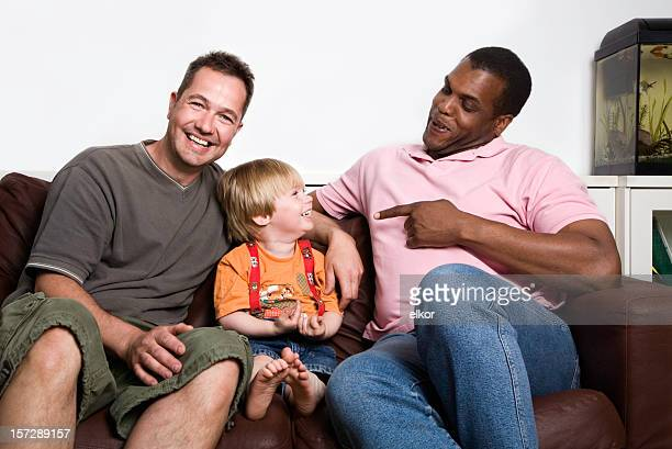 Unconventional family, two men and a child.