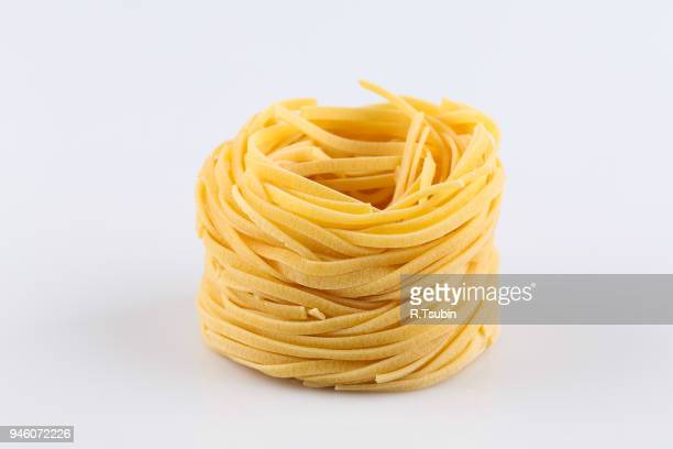 uncooked italian pasta - pasta stock pictures, royalty-free photos & images
