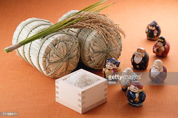 Uncooked rice and figurines
