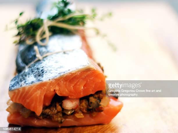 uncooked stuffed salmon - gregoria gregoriou crowe fine art and creative photography. fotografías e imágenes de stock