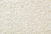 Uncooked white long-grain rice background