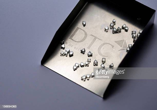 Uncut diamonds are seen in this arranged photograph at the De Beers office in London UK on Friday Nov 16 2012 De Beers the biggest diamond producer...