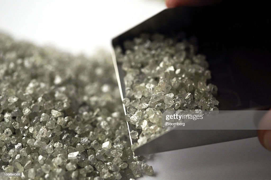 Uncut diamonds are seen in this arranged photograph at the De Beers office in London, U.K., on Friday, Nov. 16, 2012. De Beers, the biggest diamond producer by revenue, is moving the sorting and trading of rough stones to Botswana from London to secure access to the world's largest supplier of diamonds by value and challenge Antwerp's dominance as the world's biggest trading hub for rough diamonds. Photographer: Chris Ratcliffe/Bloomberg via Getty Images