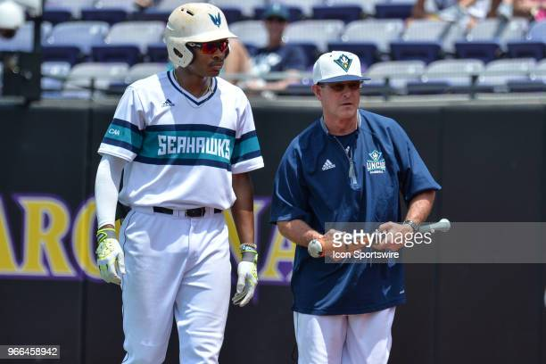 Wilmington infielder Greg Jones brings a broken bat to head coach Mark Scalf during the NCAA Baseball Greenville Regional between the Ohio State...