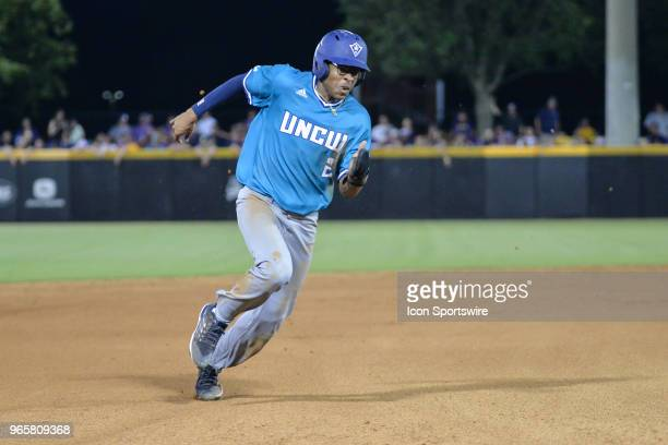 Wilmington infielder Greg Jones rounds third during the NCAA Baseball Greenville Regional between the East Carolina Pirates and the UNC Wilmington...