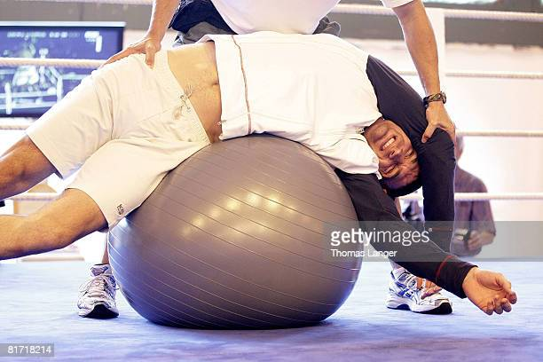 IBF IBO und WBO World Heavyweight Champion Wladimir Klitschko of Ukraine is stretching during to a training session on June 24 2008 in Going Austria...