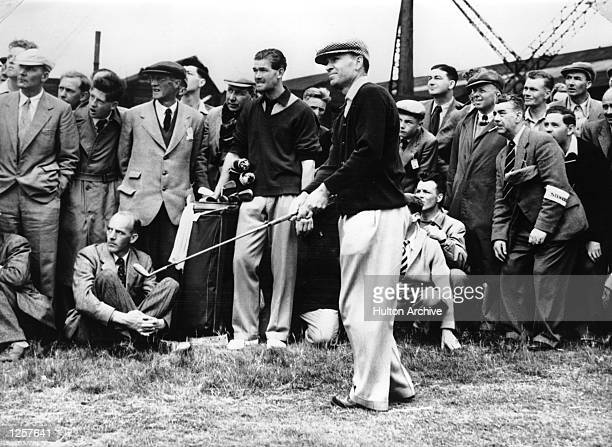 Ben Hogan of the USA plays a short iron as the gallery looks on during a golf event Mandatory Credit Allsport Hulton/Archive