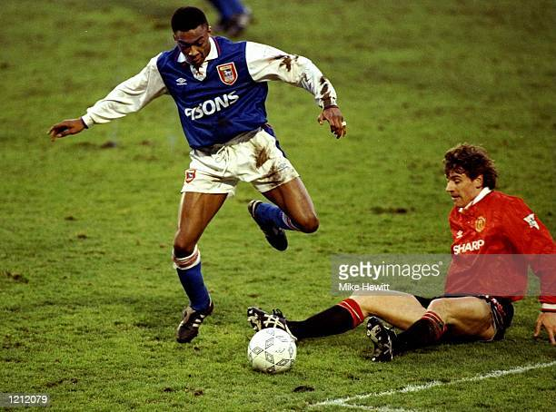 Chris Kiwomya of Ipswich Town gets the ball away from Andrei Kanchelskis of Manchester United during a match at Portman Road in Ipswich England...