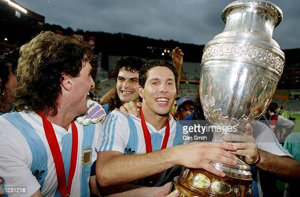 Diego Simeone of Argentina holds the trophy after their victory in the Copa America Cup final Mandatory Credit Dan Smith/Allsport