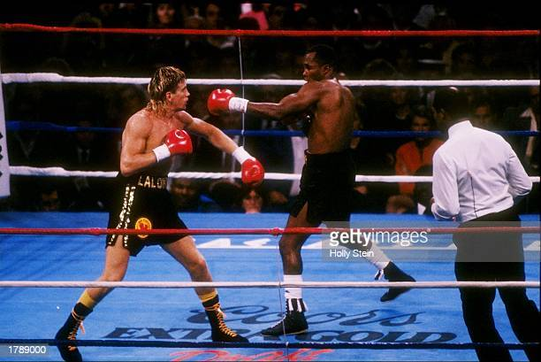 Donnie Lalonde and Sugar Ray Leonard trade blows during a bout. Mandatory Credit: Holly Stein /Allsport