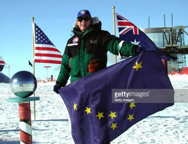 Undated File Photo Dr Ronald S Shemenski Stands At The Ceremonial South Pole Holding Alaska's State Flag At The AlmundsenScott South Pole Station In...
