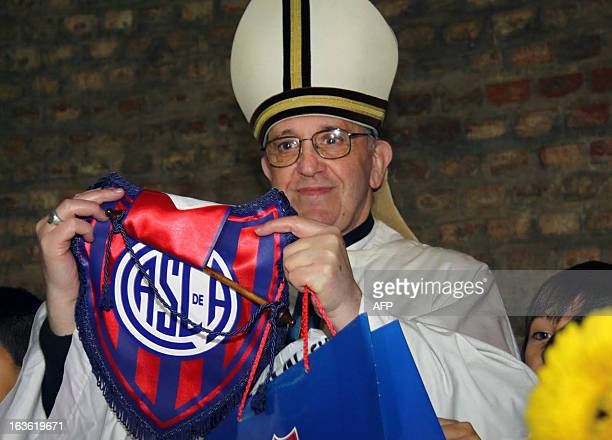 Undated file photo of Argentina's cardinal Jorge Mario Bergoglio posing with the emblem of San Lorenzo's football team which he supports in Buenos...