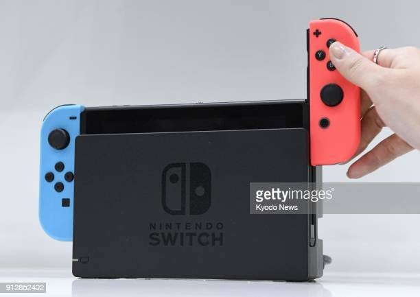Undated file photo shows a Nintendo Switch game console ==Kyodo
