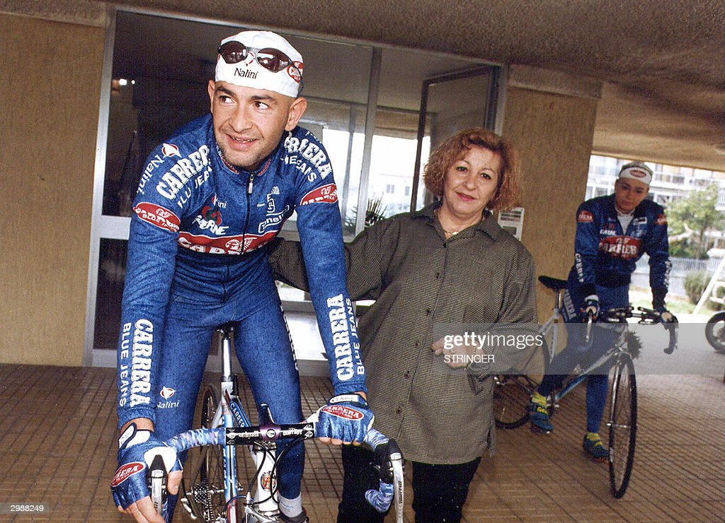 Undated file picture of Italian cycling champion Marco Pantani with his mother and former girlfriend Christina (background) in Rimini. Ahead of an official autopsy report, reports circulating today said the former Tour de France winner, who was found dead over the weekend in a hotel-residence in the chic resort of Rimini, believed he was being persecuted for his doping record. AFP PHOTO/ Stringer