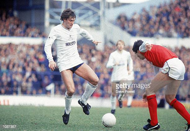 Glenn Hoddle of Tottenham Hotspur takes on Arsenal defender David O''Leary during the North London Derby League match at White Hart Lane in London...