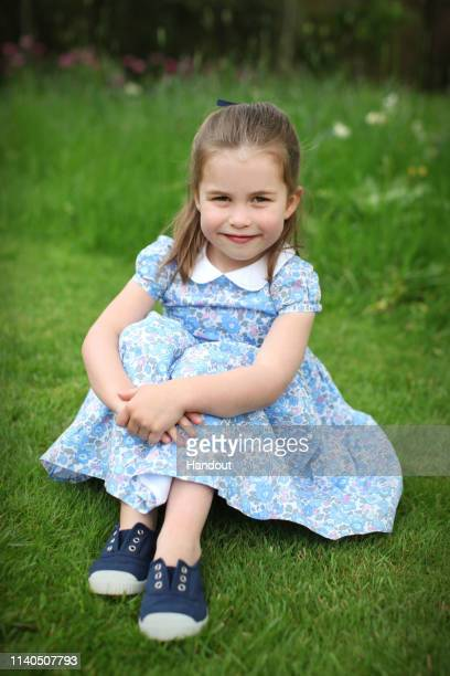 Undated handout photo of Princess Charlotte taken by her mother, Catherine, Duchess of Cambridge, at Kensington Palace in April to mark her fourth...