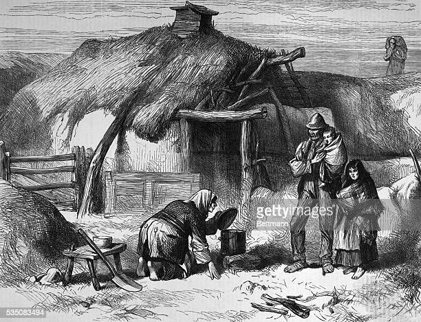 Undated illustration entitled 'BOGTROTTER'S CABIN BALLINTOBER BOG ROSCOMMON' depicting Irish crofters at the time of the famine