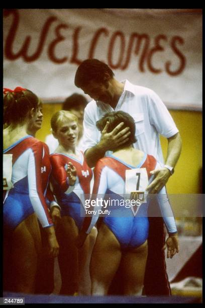Mary Lou Retton of the United States gets a hug from her coach Bela Karolyi Mandatory Credit Tony Duffy /Allsport
