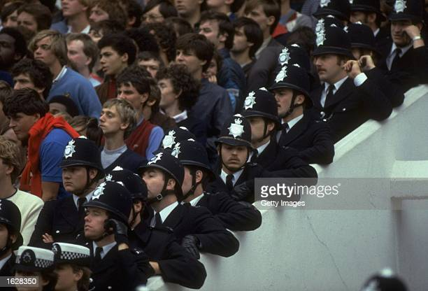 Metropolitan police stand on the steps at the edge of the crowd during a Tottenham Hotspur match at White Hart Lane in London Mandatory Credit...
