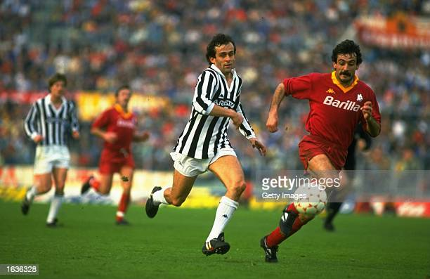 Michel Platini of Juventus chases Emidio Oddi of Roma during an Italian League match at the Olympic Stadium in Rome Roma won the match 30 Mandatory...
