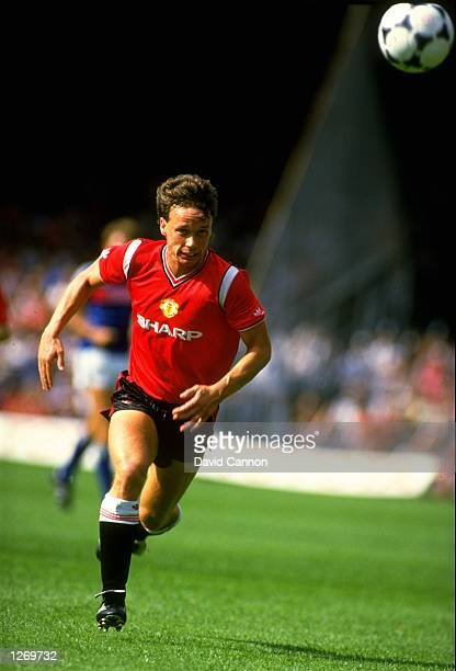 Mike Duxbury of Manchester United in action during a Canon League Division One match against Ipswich Town at Portman Road in Ipswich England The...
