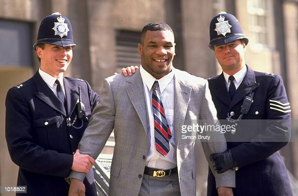 Mike Tyson of the USA is collared by the Metropolitan police on a visit to London Mandatory Credit Simon Bruty /Allsport