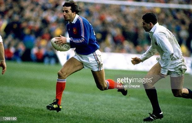 Philippe Sella of France takes on Scott Hastings of Scotland during a match at Hampden Park in Glasgow Scotland Scotland won the match 2312 Mandatory...