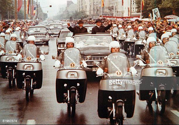 A undated photo o former Romanian communist dictator Nicolae Ceausescu waving to a crowd together with East Germany's President Erich Honecker during...
