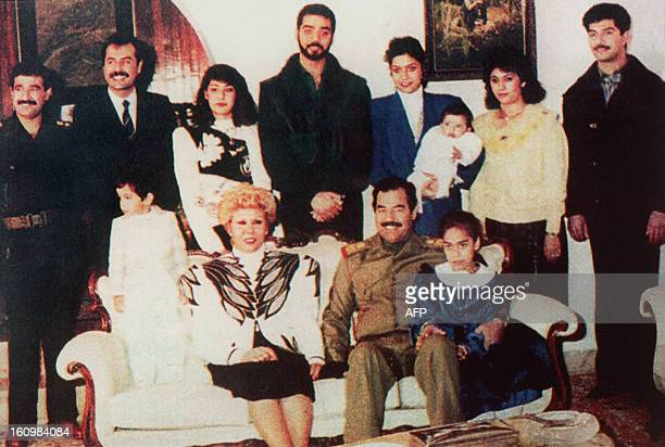 Undated photo of Iraqi President Saddam Hussein and his family in Bagdad showing Hussein 's sonsinlaw General Hussein Kamel Hassan and his brother...