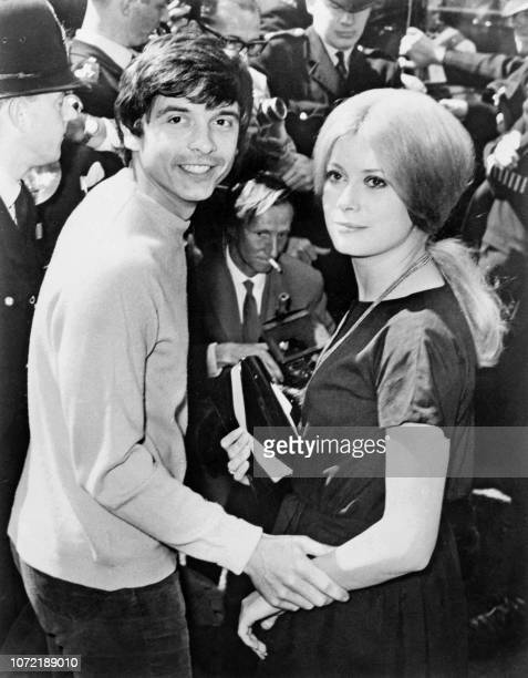 Undated photo shows French actress Catherine Deneuve and her husband British photographer David Bailey