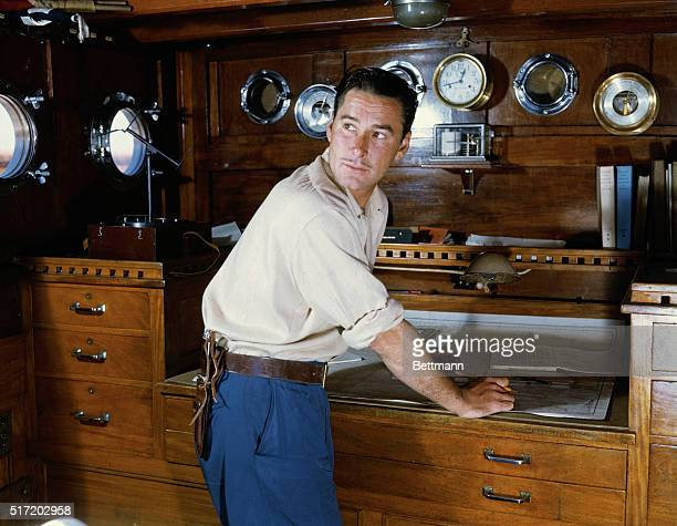 Undated photograph of actor Errol Flynn in a ship's deck