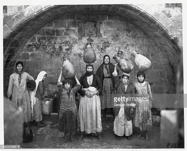 Undated photograph of Palestinian women holding water jugs on their heads