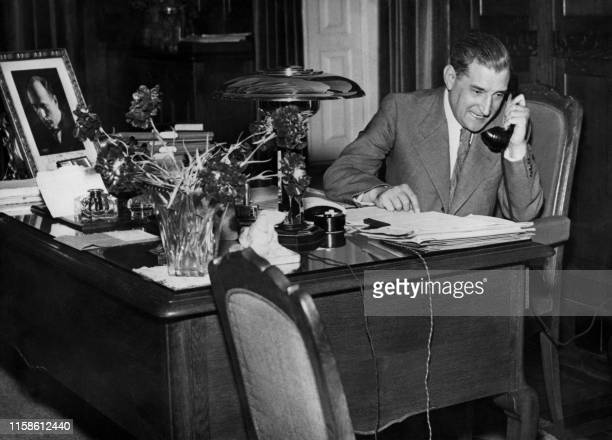 Undated picture of Portugese President Antonio de Oliveira Salazar talking on phone at his desk