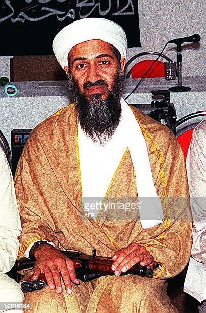 Undated picture of Saudi dissident Ossama Bin Ladin exposed inside Afghanistan Ossama Bin Ladin attends a meeting with a Kalashinkove in his lap in...