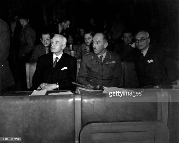 Undated picture showing British Lord Robert Wright , the president of the War crimes allied commission, and General Baers attending the Belsen's...