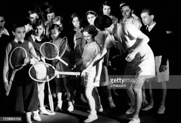 Undated picture showing French tennis player Suzanne Lenglen giving tennis lessons to the kids. - Suzanne Lenglen, who died in 1938 at the age of 39,...